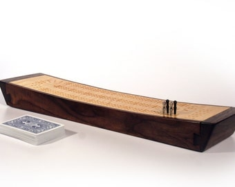 Cribbage Board - Continuous track, 3 player, swooped profile with peg and card storage. Figured maple and walnut.