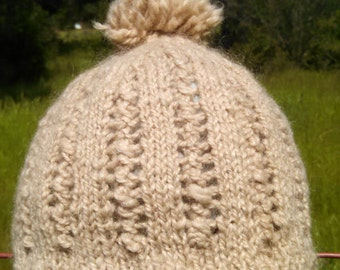 lace hat in natural ecru color, handknit from a blend of handspun  rambouoillet wool and mohair.