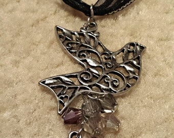 """Silver Sparrow """"Freedom"""" Pendant Multi Strand Black Ribbon Necklace With Purple and Gray Bead Accents"""