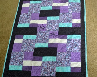 Homemade baby quilt, Purple and Teal, Birds and Bees. Patchwork pattern.