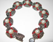 Vintage unsigned bracelet aged silver plated red enamel with pearl cabachons and magnetic clasp 7 one half inches long