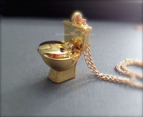 miniature gold toilet with opening lid metal oddities funny. Black Bedroom Furniture Sets. Home Design Ideas
