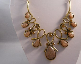 Gold Tone Bib Necklace with Shades of Brown Teardrop Pendants and Gold Rhinestones on a Gold Tone Chain