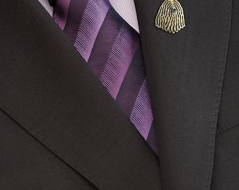 Komondor brooch - gold.