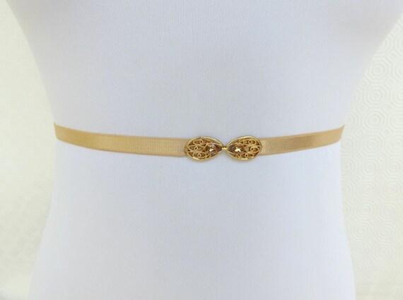 Gold Skinny Elastic Waist Belt. Gold Filigree buckle decorated with golden swarovski crystals. Thin stretch belt.