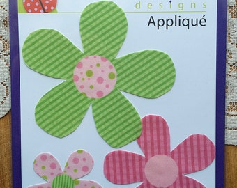 3 coordinating flower iron/sew on appliqués. Bright pink and green flowers.