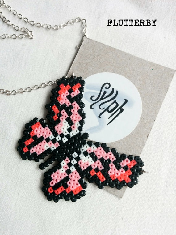 Flutterby necklace in shades of pink and bright red made of Hama Mini Perler Beads for those gamer girl butterfly lovers