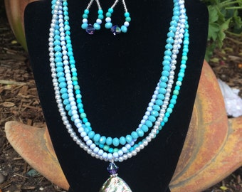 Bay Breeze - abalone shell necklace w/swarovski crystal in tanzanite, turquoise howlite & pearls in lavender and silver.  Earrings included.