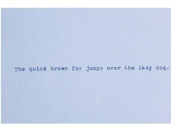 Quick Brown Fox Vintage Typewriter Quote on Blue Cardstock - Pangram - Alphabet  - Font  - Typeface