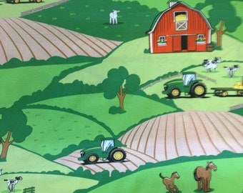 John Deere farm animal scenic has a red barn with tractors horses, cows,sheep open fields.
