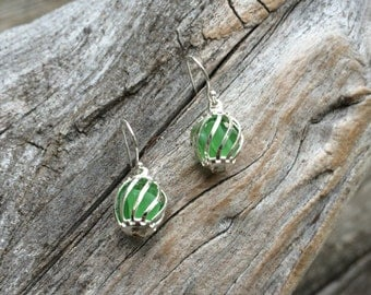 "Green ""caged"" sea glass earrings"