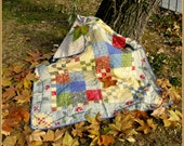 "Soft and lovely patchwork quilt made of cotton wadding and filled with ""autumn"" embroidered applique."