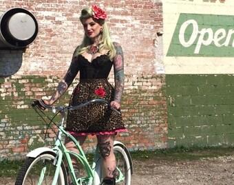 Kitten with a Whip Skirt