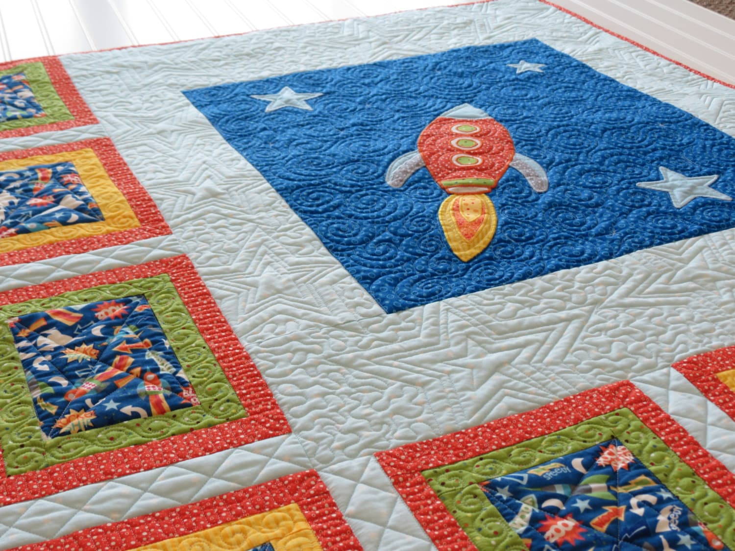 Baby quilt with rocket applique modern baby by sewyoulikeit for Spaceship quilt