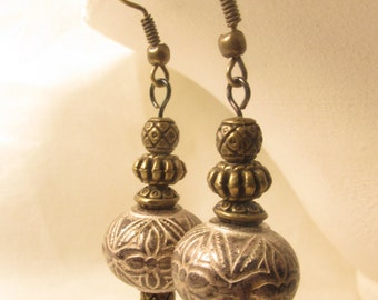 Cool reclaimed bronze and silver-toned beaded earrings on fish hook style findings - very cute!