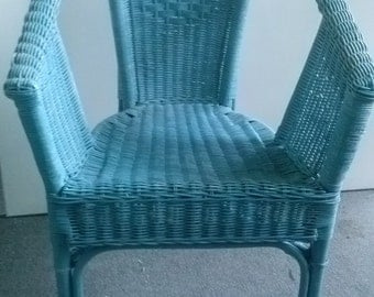 Aqua Wicker Chair a wonderful decorative addition to your home decor Shipping not included.