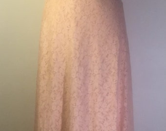 1920s peach bias cut dress with lace overall.
