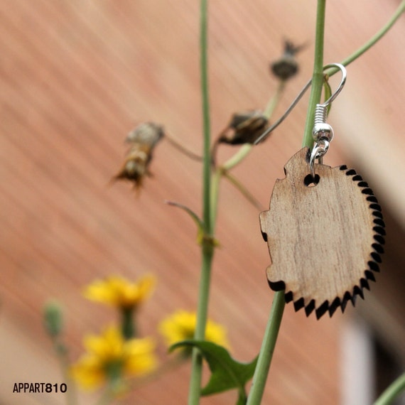 Punk. Wooden earrings are cut and laser engravings.