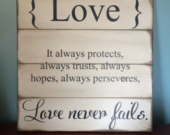 "22x22"" { Love } it always protects, always trusts, always hopes, always perseveres, love never fails. Wood sign"