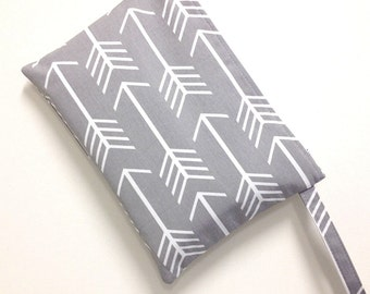 Large size wet bag with zip closure. Grey and white arrow print. Waterproof lining. Modern cloth pads. Great size for cloth diapers/nappies.