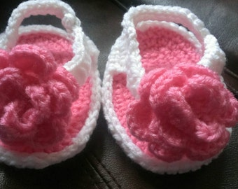 Crocheted baby girl flip flops with flower detail. Size 6-9 months.