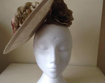 Disc shape sinamay headpiece with handmade silk flowers