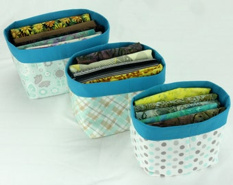 Baby's Room Fabric Stacking Bins 3 Sizes with contrasting lining folded over to create colorful trim.
