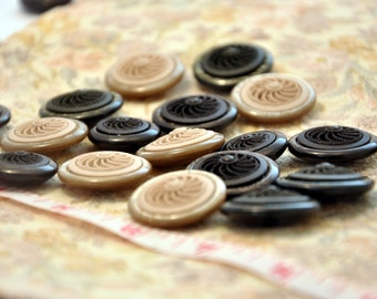 Jewelry buttons with pearl effect on the border and embossed spiral design in The centre