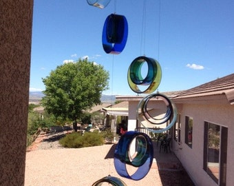 Wine bottle sun catcher. Wine bottle wind chime. Raindrop