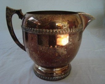 Reduced ~ SILVER PLATE PITCHER with globe shape and patina