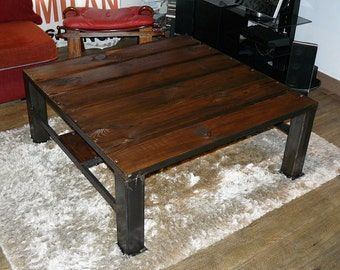 Low wooden table and made crude iron hand
