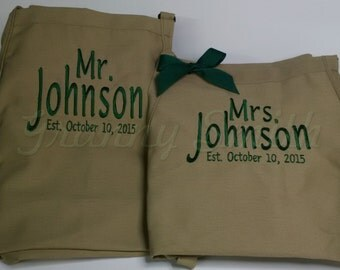"""Matching set of Embroidered Mr & Mrs Aprons. Many colors + fonts. 24""""L x 28""""W professional 3 pocket full bib. His can be longer!!!"""