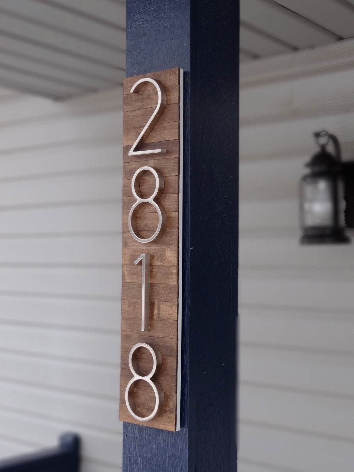 Modern house numbers plaque on stained wood for House numbers