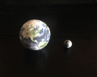 Earth and Moon globes, to scale with each other.