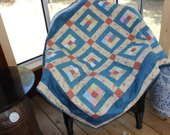 Perfect ladies throw or lap quilt in soft blues with a hint of rust