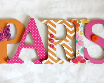 Pink and Orange wooden letters
