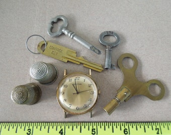 Bargain Bin Vintage Brass Keys Advertising Thimble Mechanical Watch from the Griffmeister Misc002