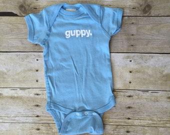 Pastel organic guppy. baby onesie