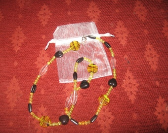 Yellow and black beaded necklace