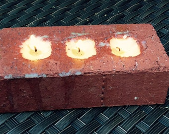 patio candle in a brick