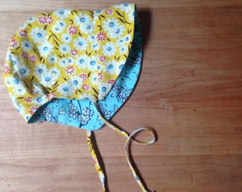 Modern yellow and blue reversible baby bonnet