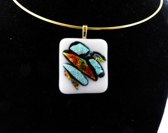 White glass with multi dichroic accents