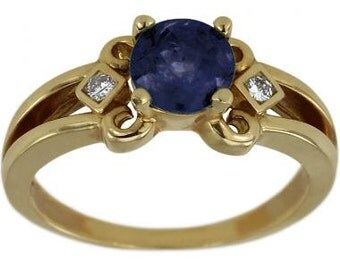 Round Blue Sapphire In A Yellow Gold Diamond Accented Engagement Ring