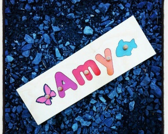 8 Letter Wooden Personalized Name Puzzle shape each side | add personalized engraved message on back for a keepsake gift.