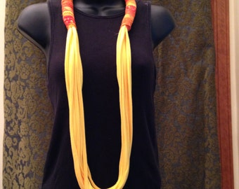 Bright yellow necklace with batik embellishment