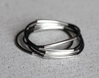 black leather bangles with two silver tubes, set of 5 bracelets