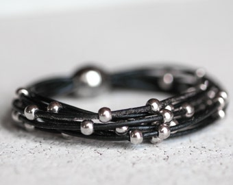 Black leather bracelet with silver beads.  Magnetic clasp