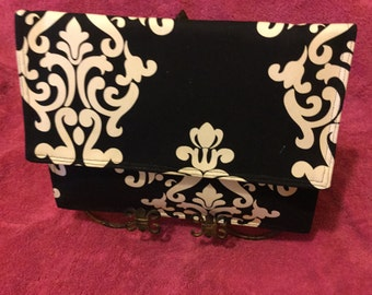 Royal, black and white clutch.