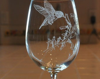 Humming bird sandblasted on wine glass