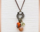 Antique bronze heart pendant necklace with orange beads cluster